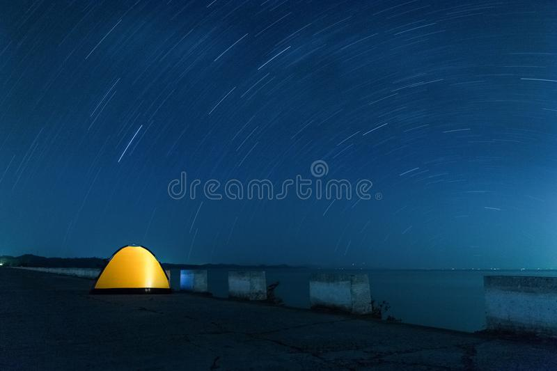 Star trails and tent royalty free stock images