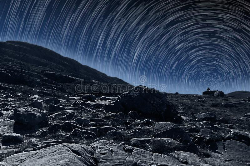 Star Trails on top of a rocky mountain royalty free stock photography