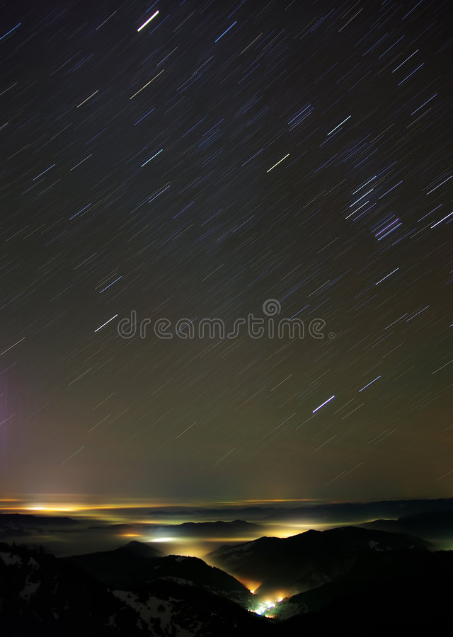 Star wars. The sky and Izvorul Muntelui valley in the night, Great visibility and 13 minutes exposure royalty free stock photos