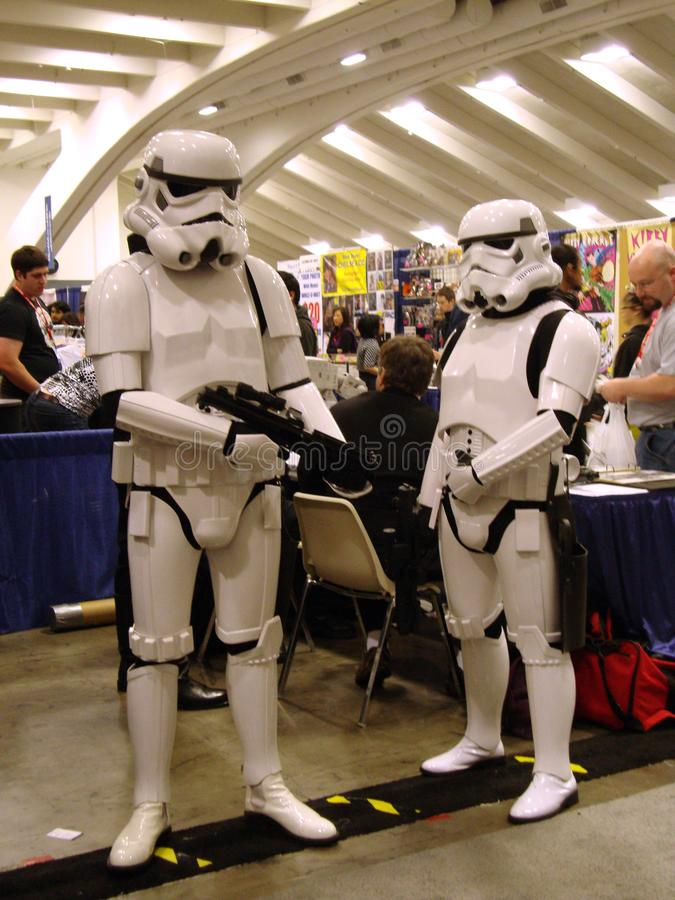 Star Wars characters Storm Troopers pose with laser guns at WonderCon event stock photo