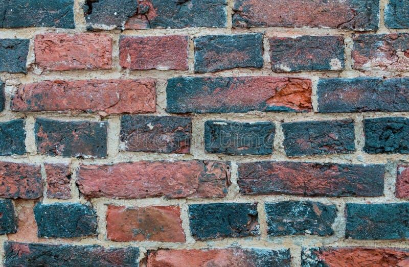 Stara ściana z cegieł w górę fotografii kolorowego szczegółu powierzchowności domu stary tekstury rocznik obrazy stock