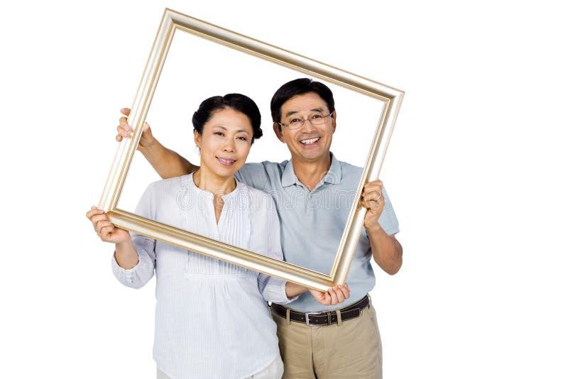 Stara azjatykcia para z ramą fotografia royalty free