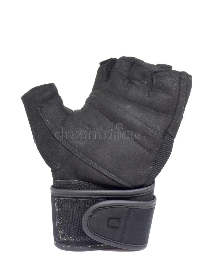 Stara czarna lewej ręki sprawności fizycznej rękawiczka na odosobnionym białym tle fotografia stock