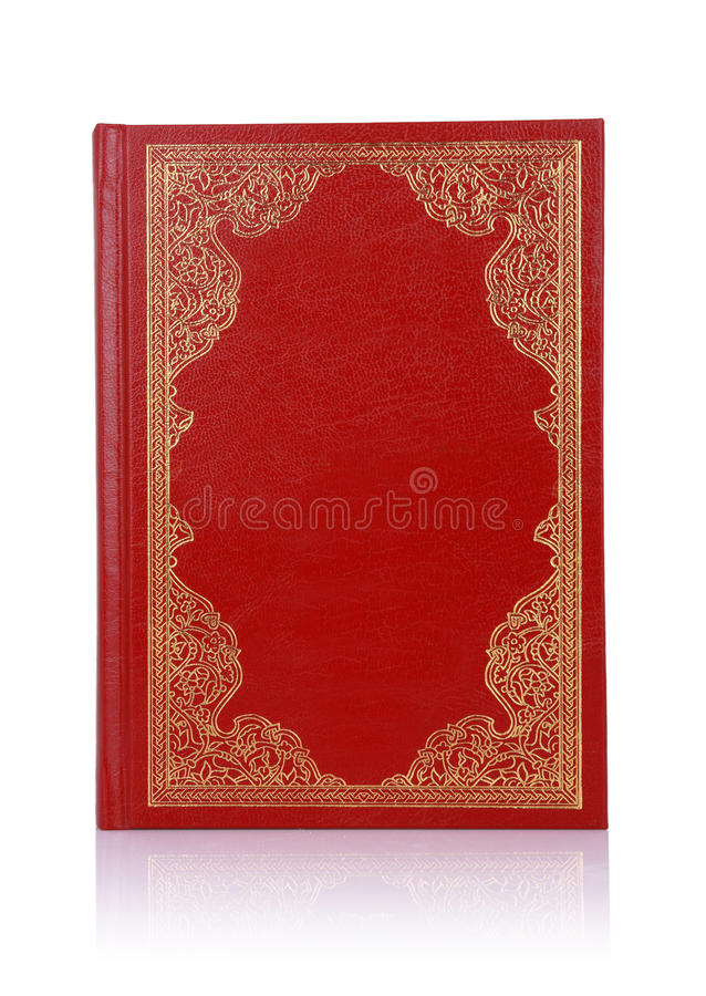 Stara czerwieni książka z złocistym koloru ornamentem na pokrywie fotografia stock