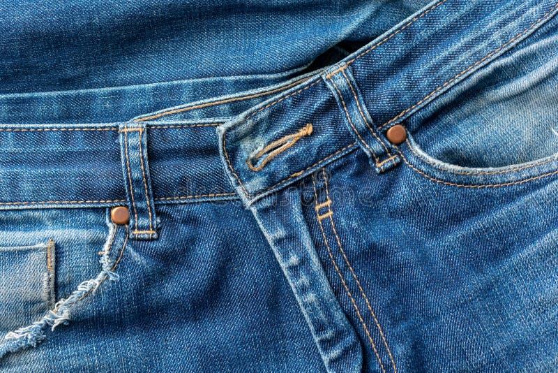 Stara drzejąca niebiescy dżinsy kieszeń Tekstura lub tło zdjęcia stock