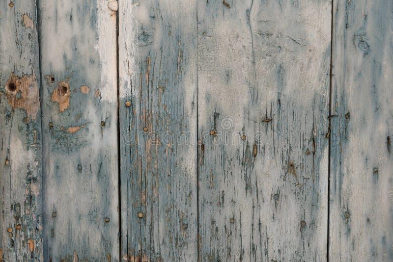 Stara i starzejąca się błękitna drewniana ściana jako zdjęcie royalty free