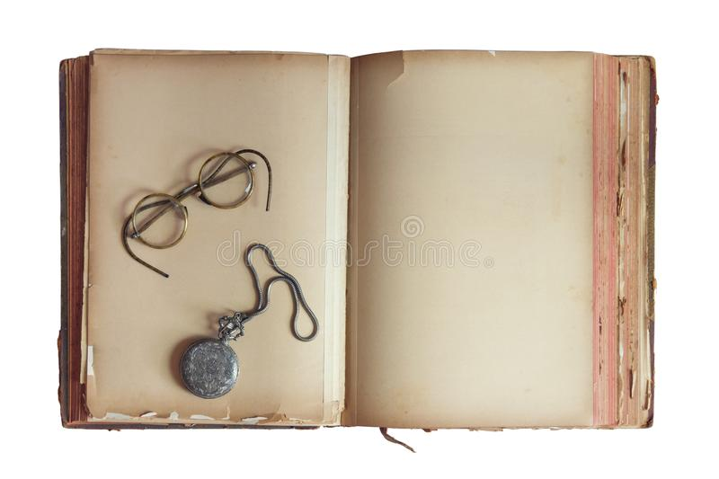 Stara książka z roczników szkłami i kieszeniowym zegarkiem zdjęcia royalty free
