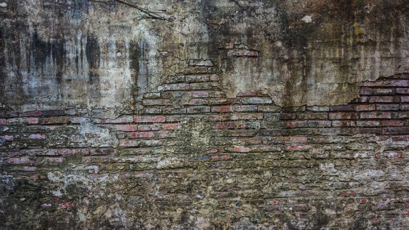 Stara nieociosana cegła i pękający tynk tekstury tło obrazy stock