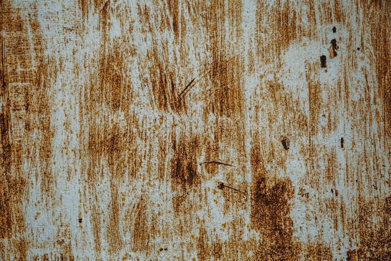 Stara ośniedziała żelazna tekstura, drapająca farba na kruszcowej powierzchni, grunge szorstki metal prześcieradło fotografia royalty free