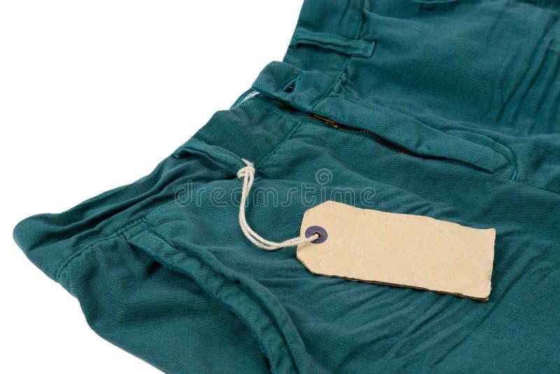 Stara papierowa etykietka z sznurkiem wiązał z spodniami obrazy royalty free