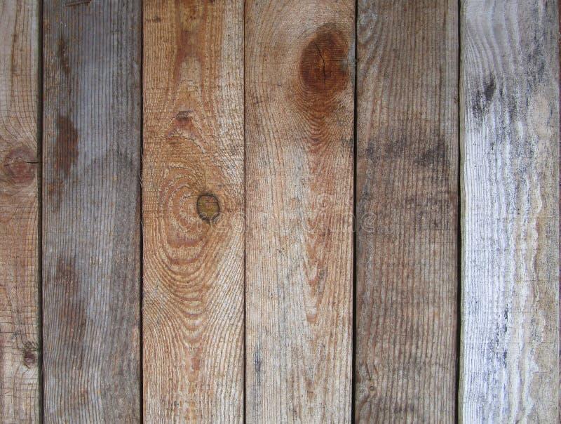 Stara pionowa pasiasta drewniana ściana, ogrodzenie, tło zdjęcie stock