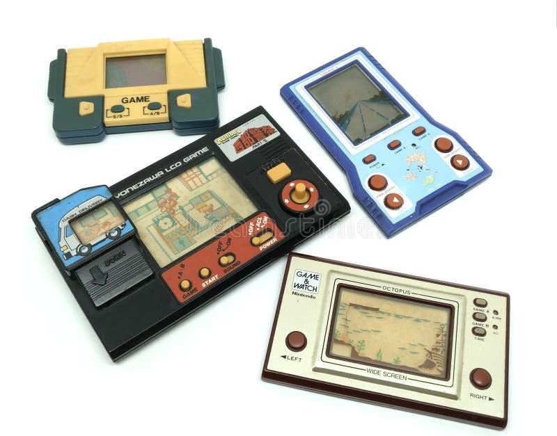 Stara przenośna gemowa konsola, Nintendo gra & zegarek ośmiornica, i oth obrazy royalty free