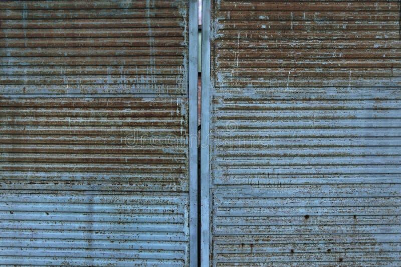 Stara zardzewiała powierzchnia Tło metalowe pomalowane metalowo Tło o strukturze brudnej i starometalowej Ściany metalowe ze zryw obrazy stock