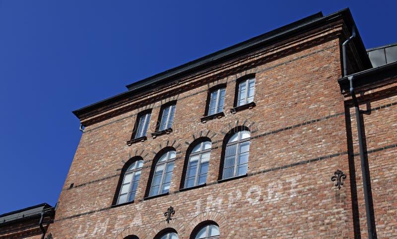 Stara zwyczaj sali fasada w Umea obrazy stock