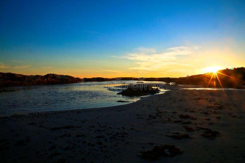 Starburst sunset Coastline Maine fotografía de archivo libre de regalías