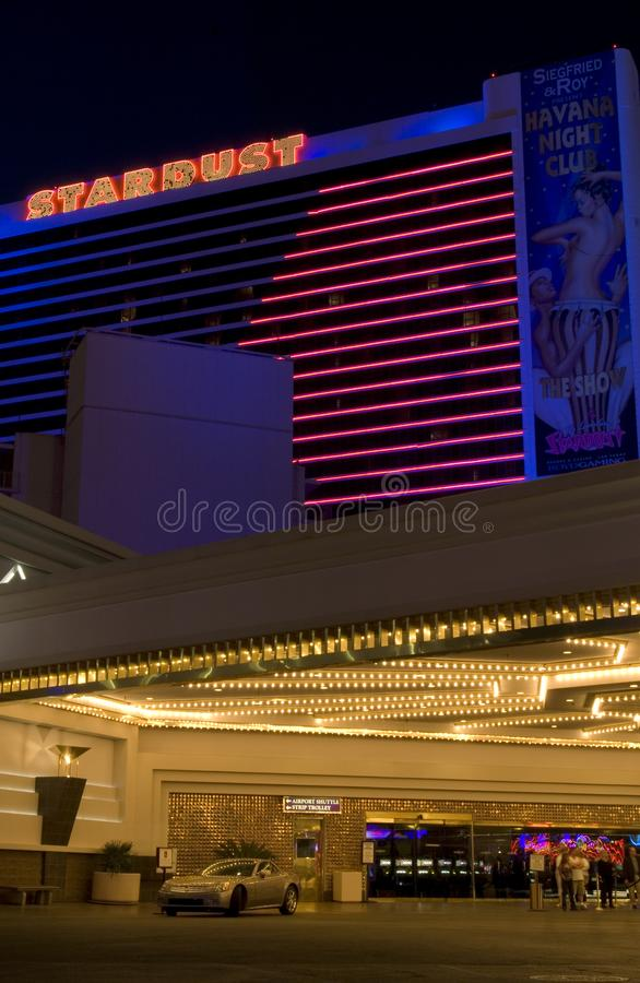 The Stardust Hotel lights up during its final year in 2006. Guests come and go from the Stardust Resort and Casino, which opened in 1958 and ultimately closed in royalty free stock photography