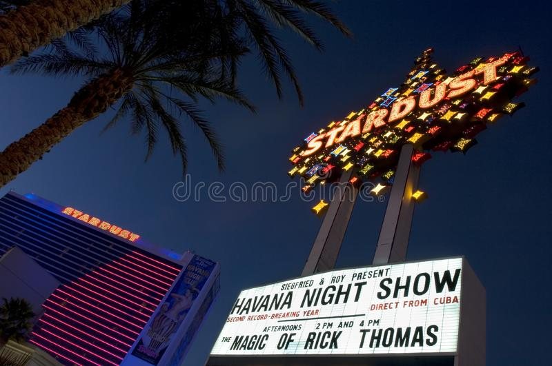 The Stardust Hotel lights ushine brightly during its final year of operation in 2006. The Stardust Hotel marque displays some local entertainment offered during stock photography