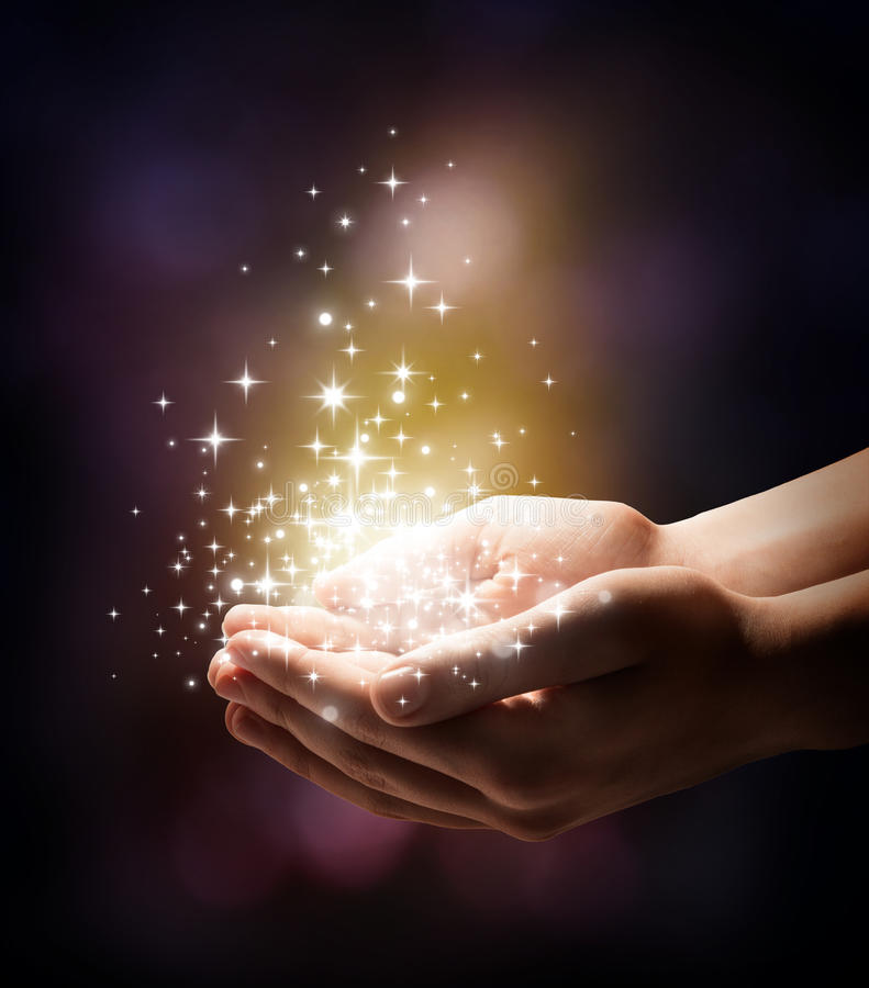 Stardust and magic in your hands royalty free stock image