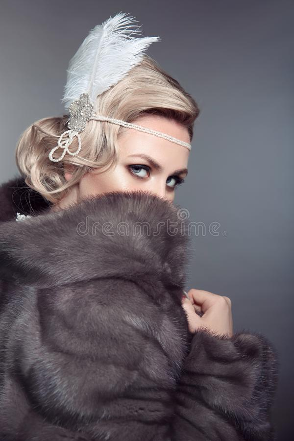 Stare. Beauty Fashion Retro Woman in Blue Mink Fur Coat. Beautiful Luxury Winter Clothes. Vintage style stock photos