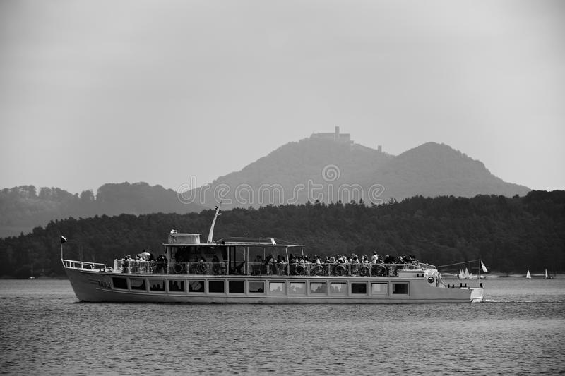 Stare Splavy, Czech republic - May 19, 2018: Steamer named Maj with tourist on board on Machovo jezero lake with Bezdez castle on stock photo
