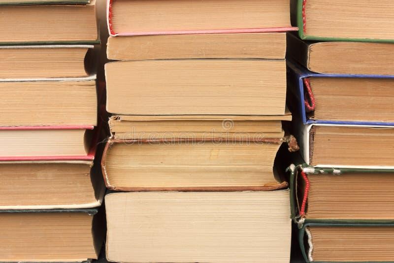 stare stosu książek Tło trzy stosu książki fotografia royalty free