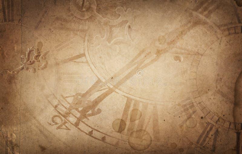 Stare zegarowe tarcze i godziny ręka na rocznika brown papieru tle zdjęcie royalty free