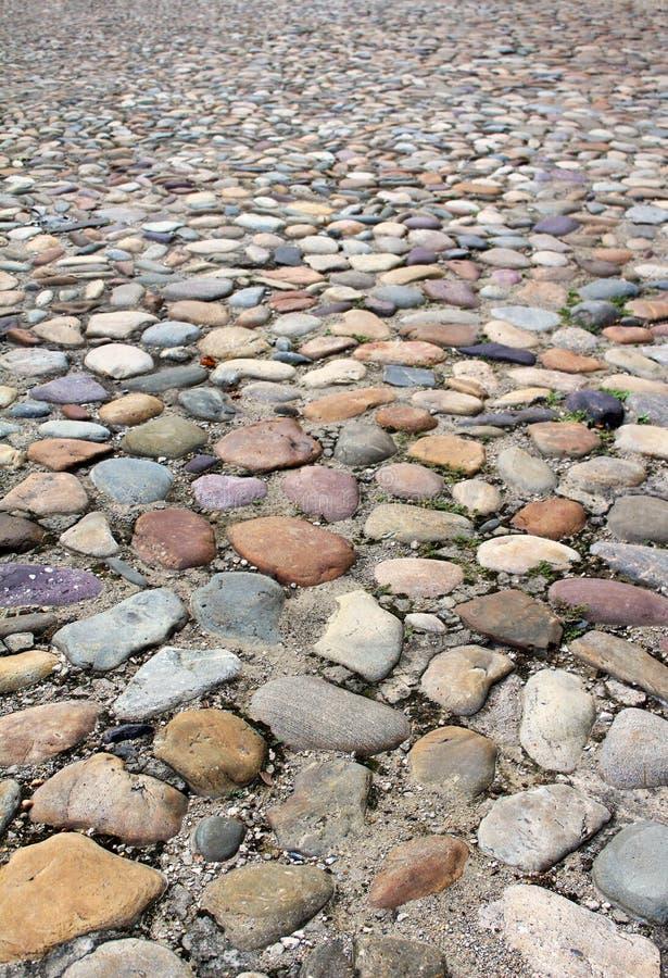 Starego brukowa tekstury drogowy tło zdjęcia royalty free