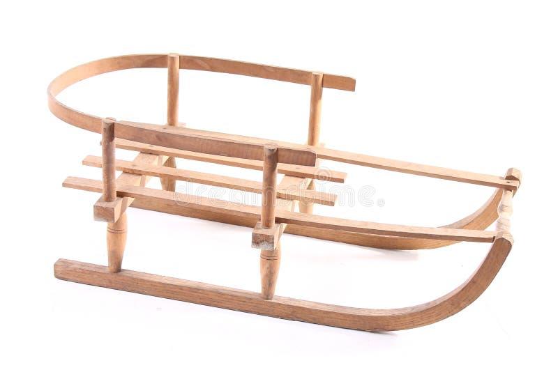 Starego drewnianego pełnozamachowego rocznika sania sporta zimy drewniani boże narodzenia odizolowywający obraz royalty free