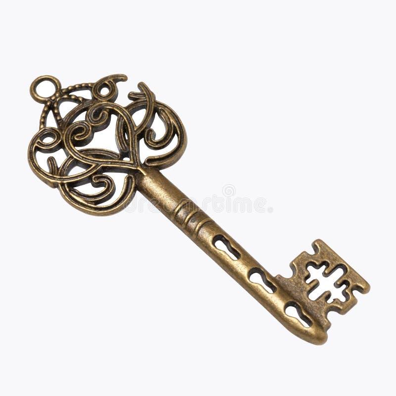 Starego złota zredukowany klucz odizolowywający na białym tle zdjęcie stock