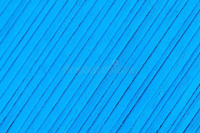 Starej krakingowej błękitnej farby drewniany płotowy tło obraz stock