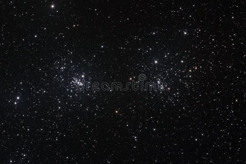 Starfield met de Dubbele Cluster stock afbeeldingen