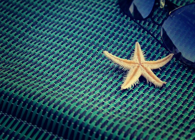 Starfish on beach mat with sunglasses instagram effect. Holiday trip vacation family summer sun sunny beach time stock images