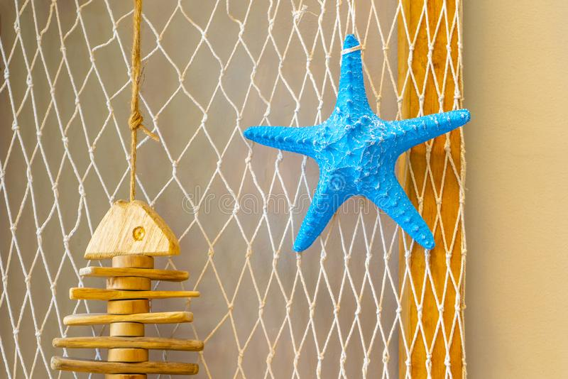 Starfish blue on the white mesh background royalty free stock images