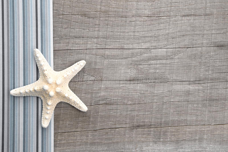 Download Starfish On Grey Wooden Background Royalty Free Stock Photography - Image: 34429817