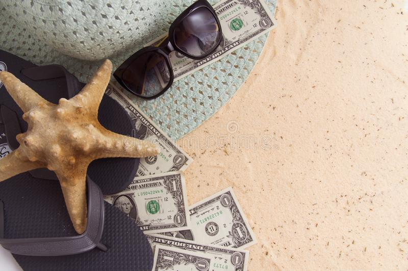 the starfish lies on the tourist accessories on the golden sand royalty free stock photos