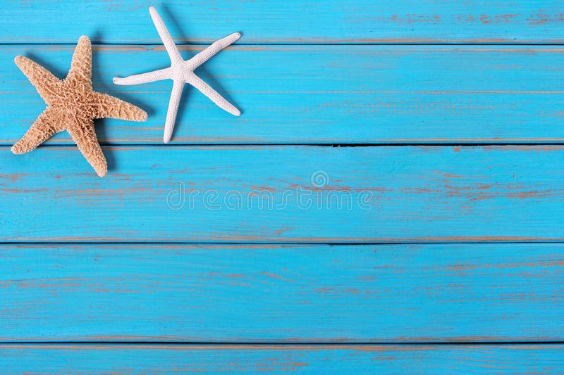 Starfish old worn blue beach tropical wood deck background border. Starfish old worn blue beach wood deck background border royalty free stock images