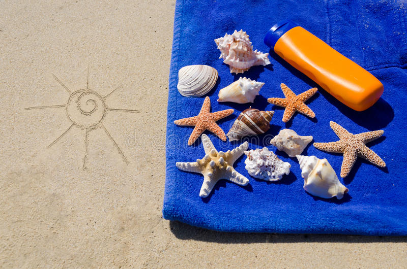 Starfishes and Seashells on the towel royalty free stock image