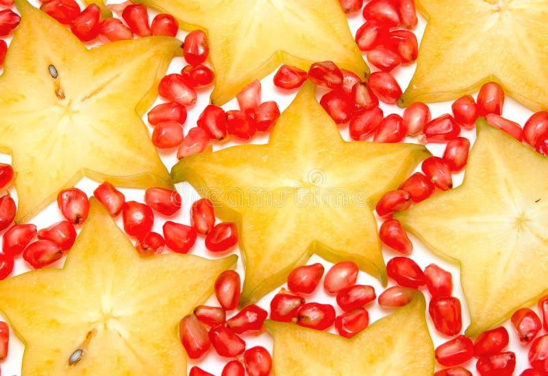 Starfruit, plak Carambola en granaatappels royalty-vrije stock afbeeldingen