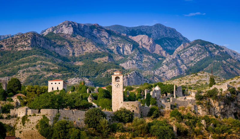 Stari Bar fortress landscape. Ancient Stari Bar fortress clock tower and walls on a mountain range background landscape. Old Bar, Montenegro royalty free stock images