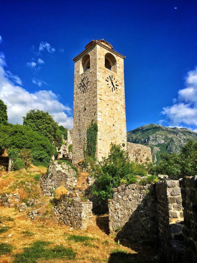 Stari Bar Fortress. Renovated tower clock among ruins of Stari Bar fortress near Bar city in Montenegro stock images
