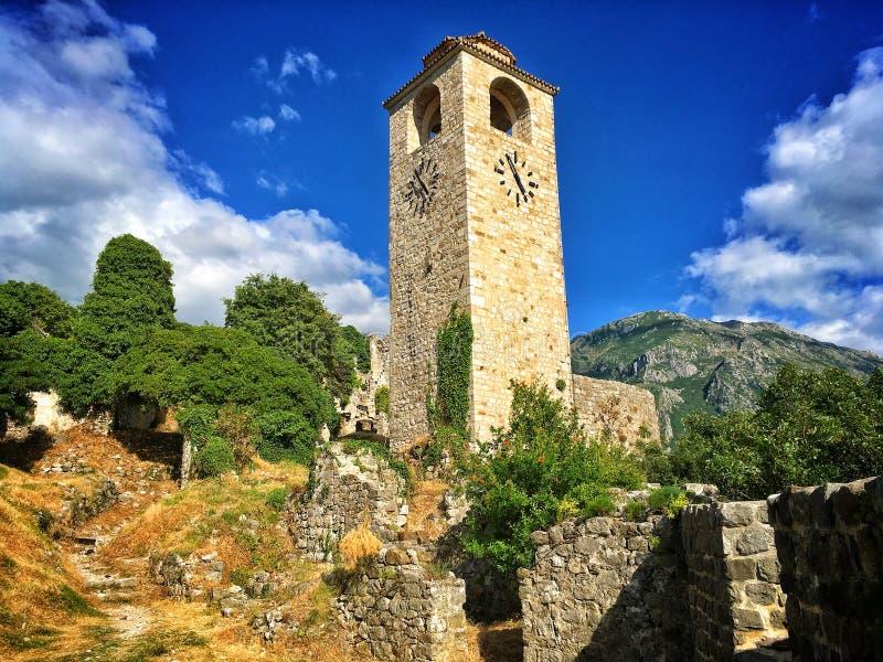 Stari Bar Fortress. Renovated tower clock among ruins of Stari Bar fortress near Bar city in Montenegro stock photo