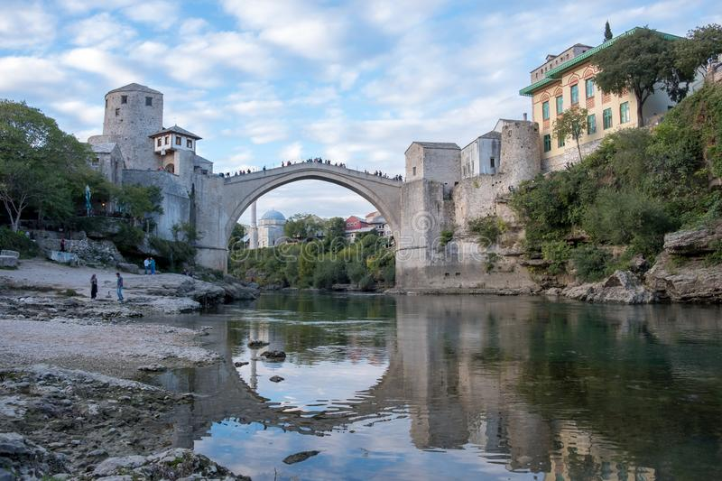 Stari Most, Mostar. Day time view of the city of Mostar`s along the river, featuring the rebuilt arched bridge: `Stari Most stock photography