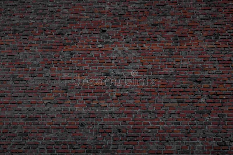 Stark vägg som göras av bakade tegelstenar royaltyfri bild