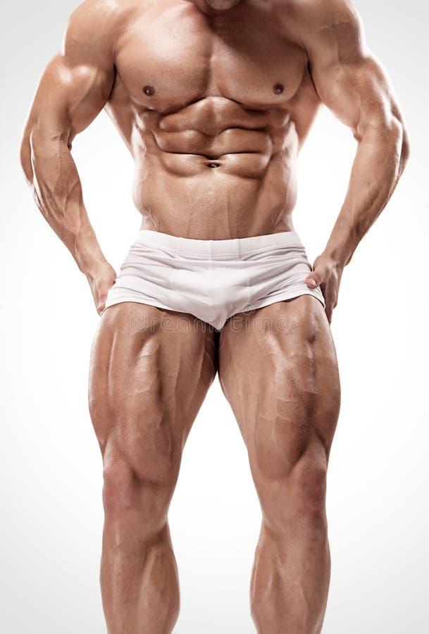 Starker Athletischer Mann Zeigt Beine Und Bauchmuskeln Stockfoto ...