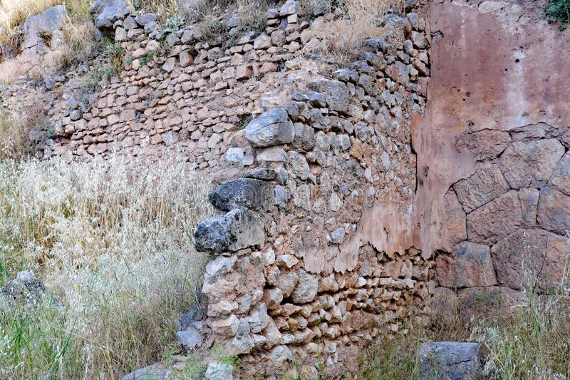 Starożytny Grek Kamiennej ściany ruiny, Delphi, Grecja zdjęcie stock