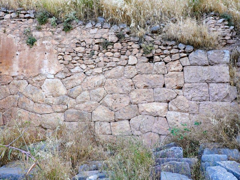 Starożytny Grek Kamiennej ściany ruiny, Delphi, Grecja fotografia stock