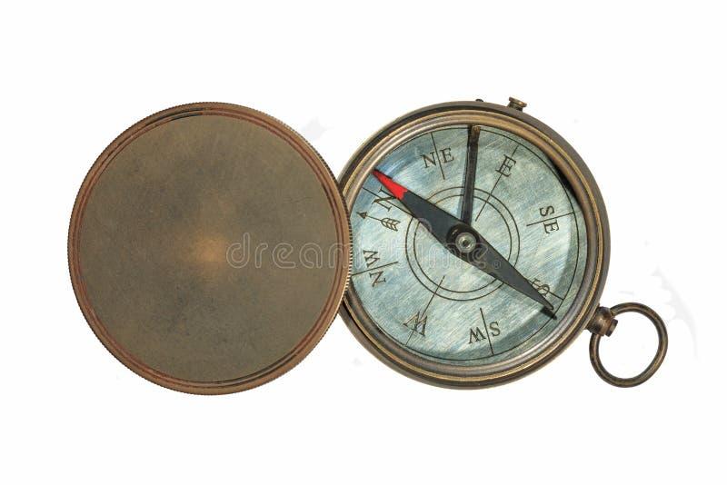 Staromodny magnesowy kompas i dekiel obrazy royalty free