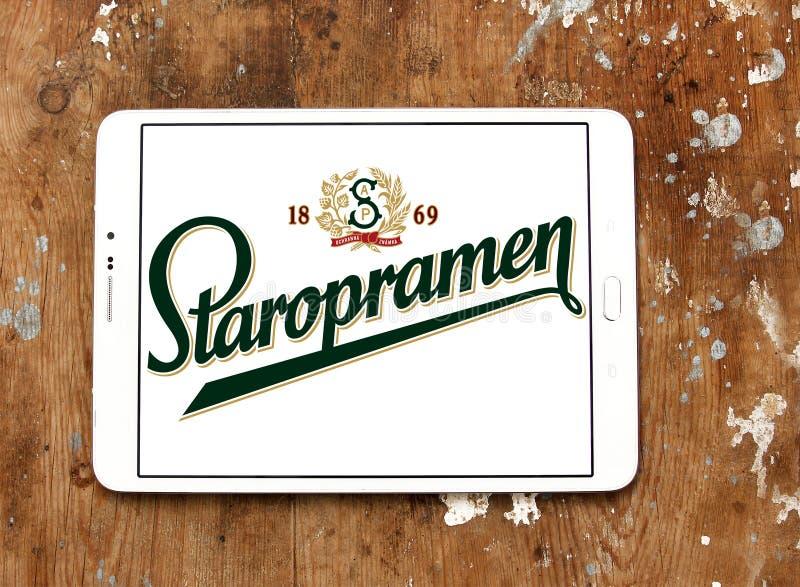 Staropramen beer logo. Logo of beer drinks company staropramen on samsung tablet on wooden background royalty free stock images