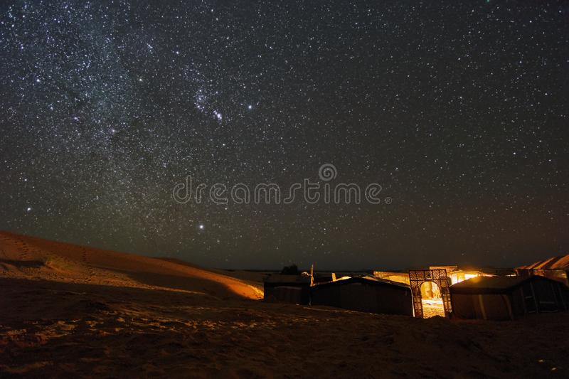 Starry night above the desert campsite in Sahara royalty free stock photos