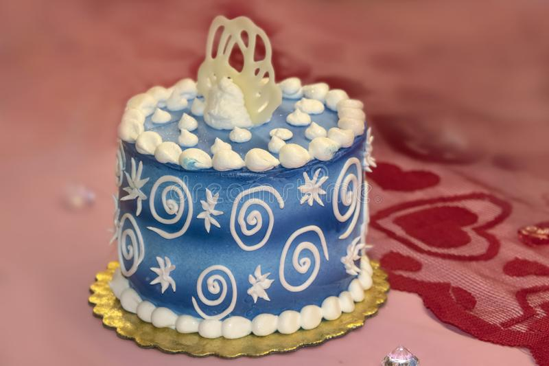 Starry starry night decorated cake with blue and white icing on pink background with lace with hearts - selective focus.  stock images